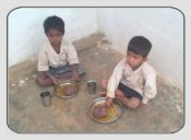 two boys eating at the orphanage in Bangalore